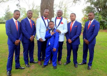 The groom, bestman and paige boy wore a tuxedo while the grooms men used a suit.