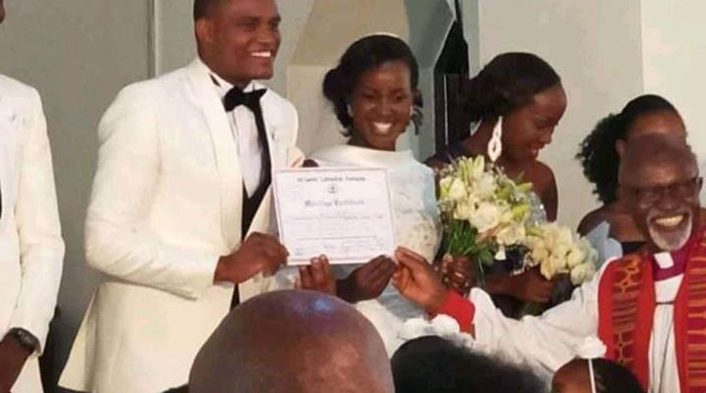 The couple shows off their marriage certificate, evidence that they are now one in the eyes of God and man alike
