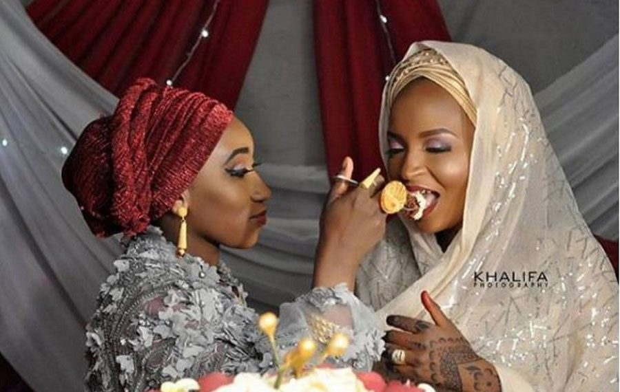 First wife feeds her husband's second wife on their wedding